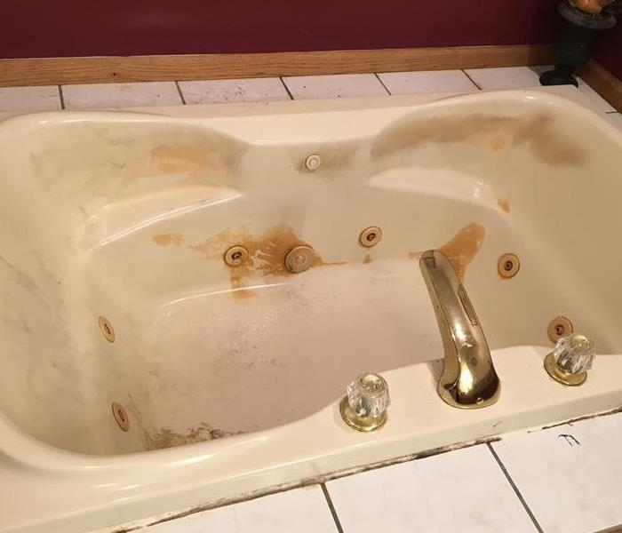 Bath Tub Damaged by Fire
