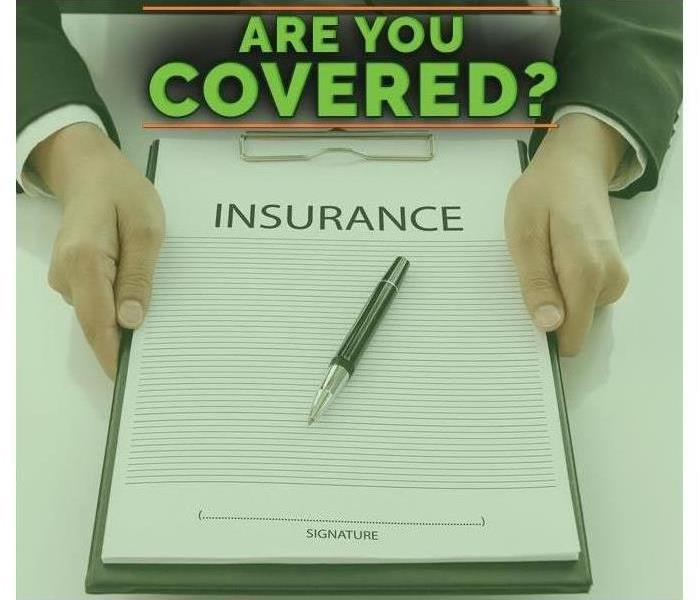 Man Holding Insurance Sign Up Form.